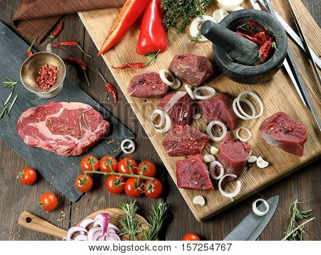Meat for a grill - beef steak and shish kebab.