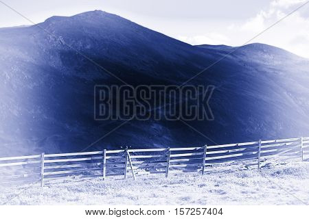 Norway fence in mountains blue sepia background hd