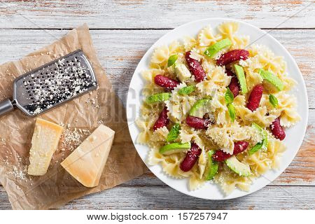 Sausages Bowtie Pasta Warm Salad With Avocado Slices And Cheese