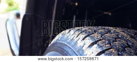 Close up tire tread new car background.