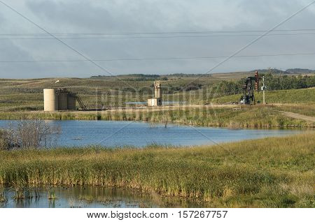 An active oil well next to a wetland in North Dakota