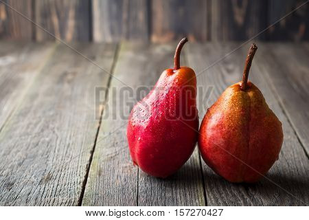 Red sweet juicy pears on a dark background. Selective fokus.Rustik style.