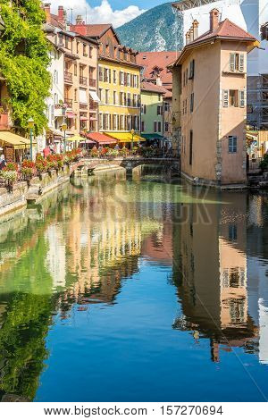 ANNECY,FRANCE - SEPTEMBER 2,2016 - Street reflection in river Thiou of Annecy. Annecy is the largest city of Haute Savoie department in the Auvergne Rhone Alpes region in southeastern France.