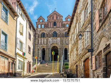 LE PUY EN VELAY,FRANCE - SEPTEMBER 2,2016 - View at the facade of cathedral Notre Dame de Puy in Le Puy en Velay. Le Puy en Velay is a commune in the Haute Loire department in south-central France near the Loire river.