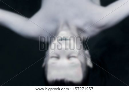 Drowned Young Boy Float in the Dark Water Blurred