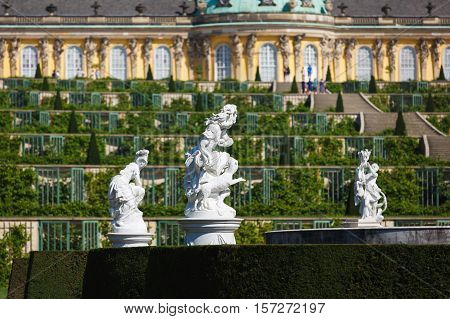 Potsdam Germany - August 27 2016: View of the statues in a garden of Sanssouci famous landmark of Potsdam summer time