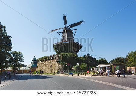 Potsdam Germany - August 27 2016: Some people are resting near the old windmill in Potsdam summer time