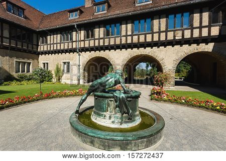 Potsdam Germany August 27 2016: Fountain in the courtyard of the Cecilienhof Palace in Potsdam summer time