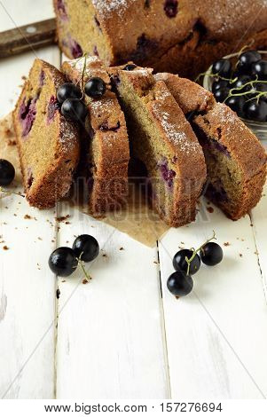 Homemade wholewheat cake with blackcurrant, vertical, copy space