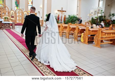 Wedding Couple Going To The Lord's Table Altar On Wedding Ceremony At Church.