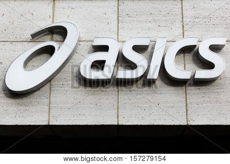 Paris, France - March 25, 2016: Asics is a Japanese multinational corporation athletic equipment company which produces footwear and sports equipment