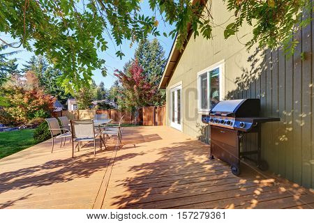 View Of Back Yard With Wooden Walkout Deck