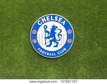 London, the UK - May 2016: FC Chelsea emblem against green grass background