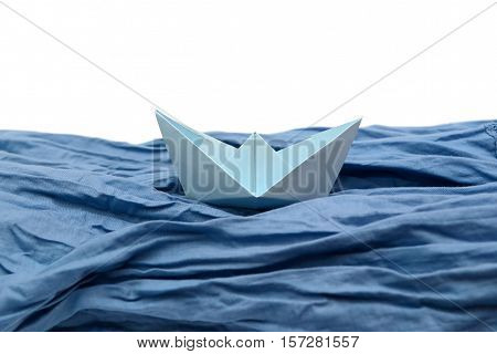 Blue paper boat, origami boats on white