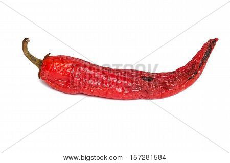 Rotten chili pepper isolated on white background. The natural color and texture. Spoiled vegetables.