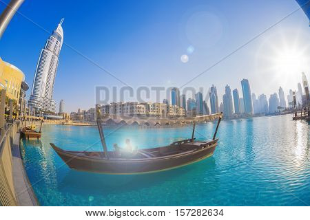 Dubai Lagoon With Boat Against Sunset In Uae