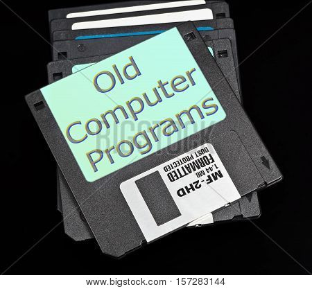old floppy disk with a capacity of 1.4 megabytes on a black background. Upper inscription: Old computer programs