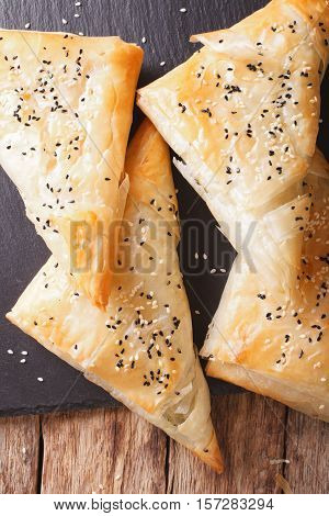 Triangles Of Phyllo Pastry Stuffed With Chicken, Spinach And Cheese Closeup. Vertical Top View