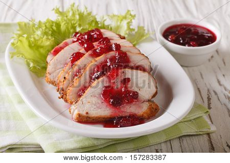 Festive Food: Roasted Fillet Of Turkey With Cranberry Sauce On A Plate Close-up. Horizontal