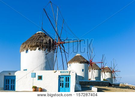 Mykonos Greece - October 15 2012: The historic windmills on the promontory of the Chora old town