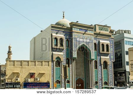 DUBAI UAE - NOVEMBER 10 2016: Ali bin Abi Taleb Mosque in old city Deira Dubai. The creek is divides the city into two main sections Deira and Bur Dubai old downtown of Dubai.