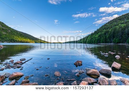 Jordan Pond at Acadia National Park. Daytime Rocky shore with still translusent water