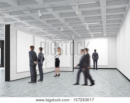 Woman and men are standing in an art gallery with blank posters hanging on the walls. Concept of modern art and advertising. 3d rendering. Mock up.