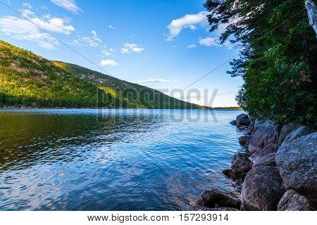 Jordan Pond at Acadia National Park. Daytime Rocky shore with still translusent water