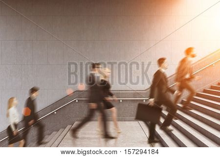 Side View Of Entrepreneurs Climbing A Stair In A Building, Toned
