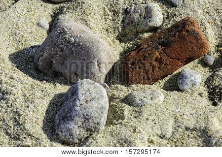 Rocks brick sandy beach Cape Cod texture jumble strewn
