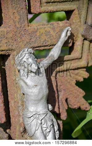 Ancient crucifixion with broken one hand Jesus christ and rusty cross