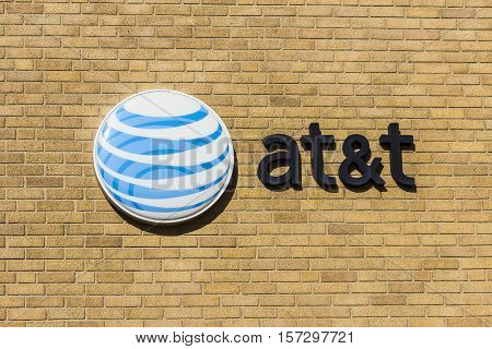 Kokomo - Circa November 2016: AT&T Corporate logo and signage on a downtown central office. AT&T now offers Uverse VoIP Cell Phones and DirecTV XIV