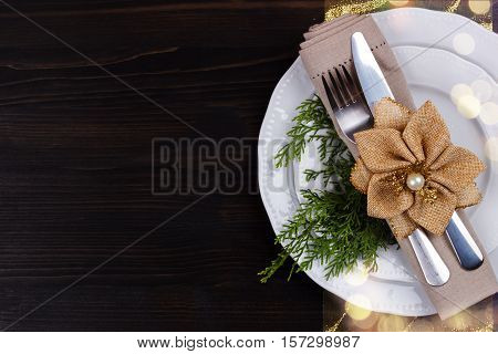 Christmas table setting on brown old wooden table.Christmas card template