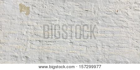 White Wash Shabby Uneven Old Plastered Horizontal Wall Texture Background.