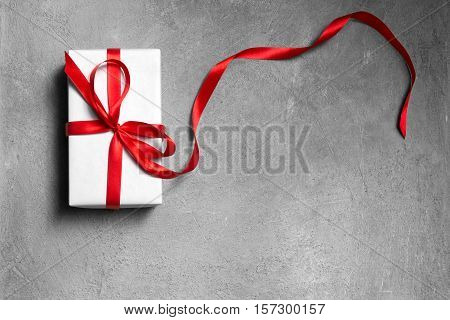 beautiful New Year's or Christmas gift on a gray background