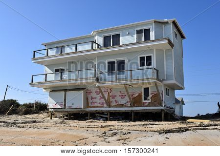 VILANO BEACH, FLORIDA, USA - NOVEMBER 9, 2016: Aftermath of beach house damage caused by hurricane Matthew hitting the east coast of Florida on October 7, 2016.