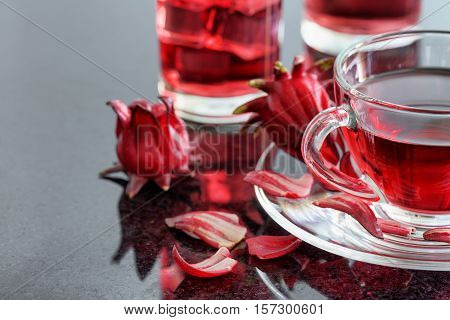 Closeup View Of Cup Of Hibiscus Tea (rosella, Karkade) On Table