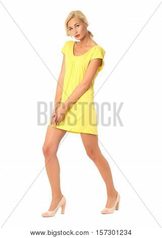 Portrait Of Flirtatious Woman In Short Yellow Dress Isolated On White