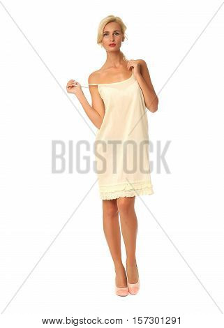 Full Length Of Flirtatious Woman In White Dress Isolated On White