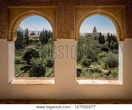 Granada Spain - 8th September 2016: A view from twin windows in the Alhambra Palace.