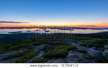 View from Cadillac mountain. Acadia National Park Maine. Sunrise. Bar Habor lights in the distance