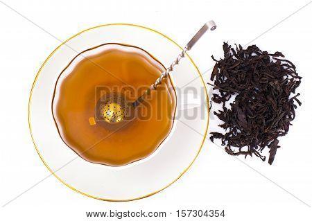 tea and a strainer for tea leaves. Studio Photo