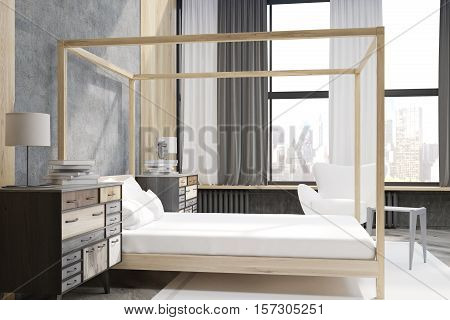 Side View Of A Bedroom With Pillared Bed And Large Windows