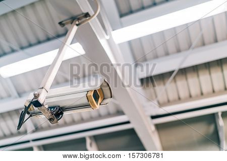 Surveillance security CCTV camera on the roof at night safety or security concept