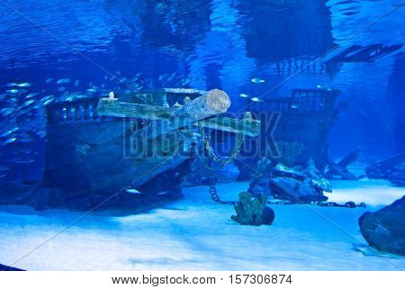 Dark blue water with sunken ship wreckage