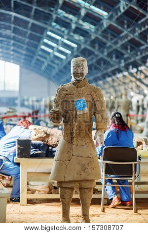 Chinese Archaeologists At Excavation Site Of The Terracotta Army