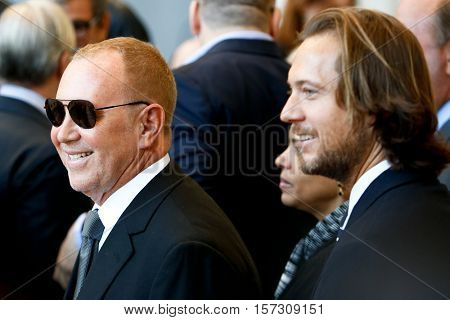 NEW YORK-MAY 5: Michael Kors (L) and Lance LePere at the ribbon cutting ceremony for the Anna Wintour Costume Center Grand Opening at the Metropolitan Museum of Art on May 5, 2014 in New York City.