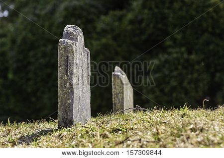 Headstone in old graveyard on New England hillside