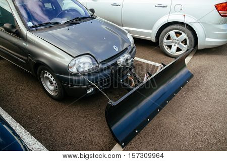STRASBOURG FRANCE - CIRCA 2016: Snow plow attached to a passenger Renault car