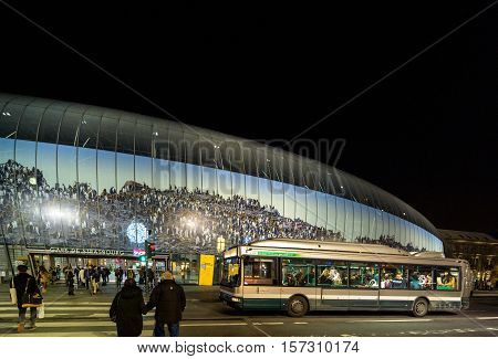 STRASBOURG FRANCE - DEC 19 2016: Large view of Place de la Gare with Gare de Strasbourg - or Strasbourg at dusk. It is the eastern terminus of the Paris-Strasbourg railway.